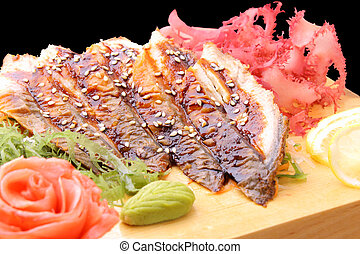 sashimi unagi on a board closeup - sashimi unagi with slices...
