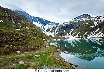 Reflections on the summer alpine lake - Alps mountains...