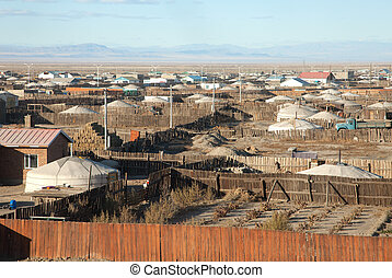 A typical Mongolian city. Small houses and traditional yurts...