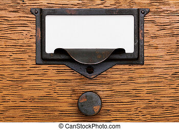 Blank Label In Old Drawer Pull - Close up of a blank, white...
