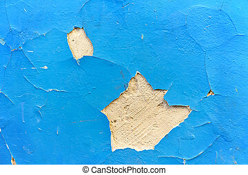 Cracked paint on an old plaster wall