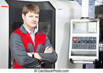 laborer worker with machining tool center - mechanical...
