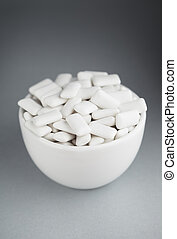 Gum - White chewing gum in a white bowl