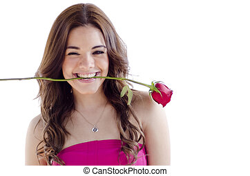 Cute young woman biting a rose
