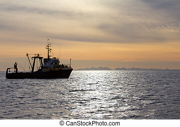 Fishing trawler during a storm in Pacific ocean near...