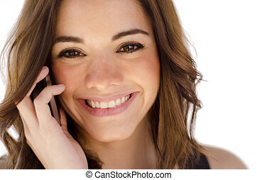 Cute girl talking over the phone - Young beautiful woman...