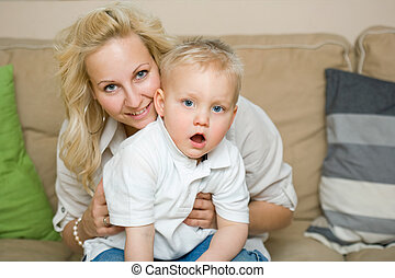 Cute family - Indoors portrait of young child with his...