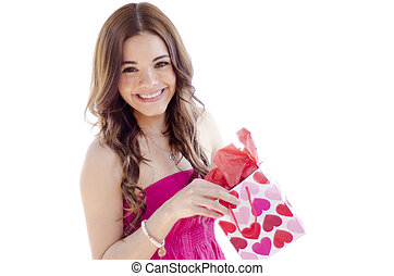Happy young woman opening a gift