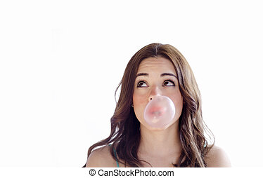 Cute girl making a bubble with gum - Young beautiful woman...