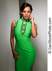 Latina - Pretty young Latina in a green sheath dress
