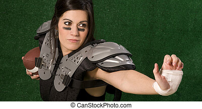 Stiff Arm - A woman football player practices her stiff arm