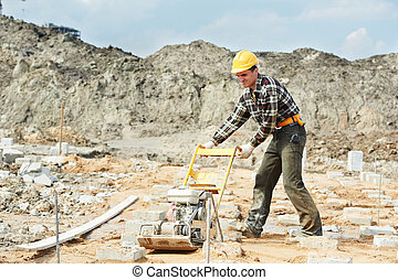 concrete worker work with pla compactor - builder worker at...