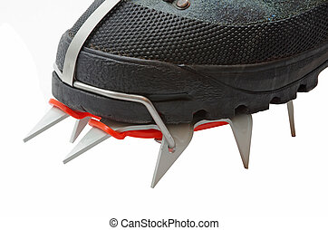 Trekking boot with crampons on a white background