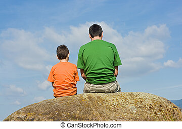 From father to son - the big talk concept - Father giving...