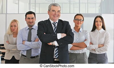 Careerists - Business team with a mature leader at the head...