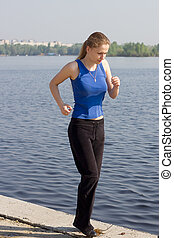 woman running outdoors in sunshine