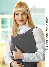 Lady in business - Smiling woman dressed formally looking at...