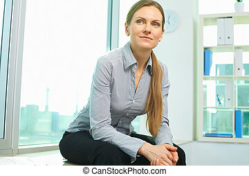 White collar worker - Smiling business woman sitting in...