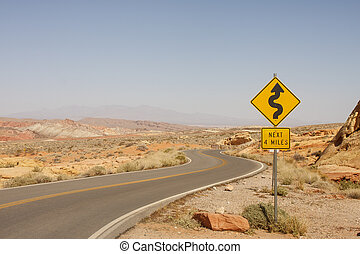 Road Sign for Curves in Desert