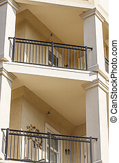 Stucco Balconies with Wrought Iron Railings - Two balcones...