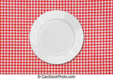 White plate on red and white tablecloth