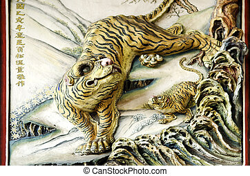tiger sculpture in chinese temple, penang malaysia