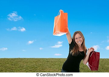 Woman with shopping bags outside