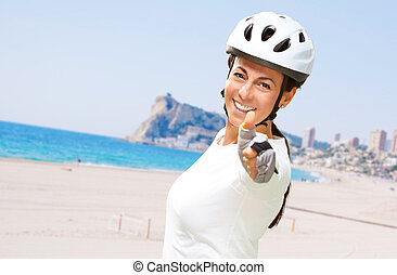 portrait of a cheerful sporty middle aged woman doing a...