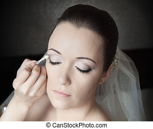 Brides Preparation - Beautiful bride having her make-up done...