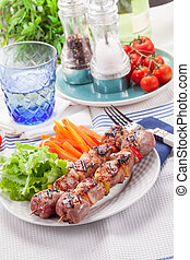 Meat Skewers with Carrots and Salad