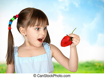 Funny surprised child girl with strawberry