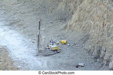 construction drill machine in quarry at work
