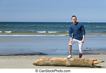 Young male standing on the beach