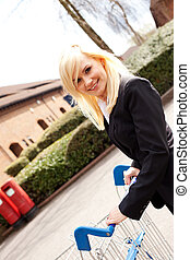 Attractive woman pushing a shopping trolley