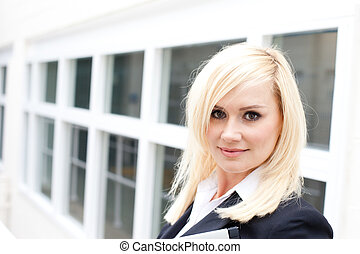 Pretty blonde businesswoman with paperwork
