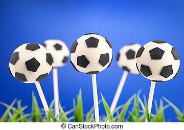Soccer ball cake pops - Round-shaped mini cake sdipped in...