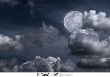 Beautiful full moon behind fantasy cloudy sky
