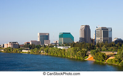 Sacramento California - Skyscrapers next to a river in...