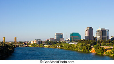 Sacramento California - Skyscrapers next to river in...