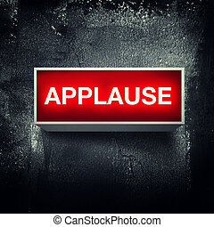 "Applause - ""Applause"" warning board message is lit on."