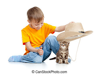 adorable boy playing with kitten isolated on white