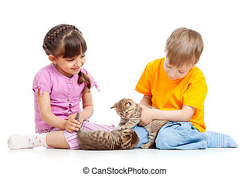 Kids boy and girl playing with kittens. Isolated on white background