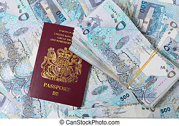 Big Qatar money deal - A British passport mixed in with a...