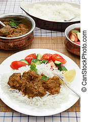 Madras butter beef meal vertical - A plate of Madras butter...