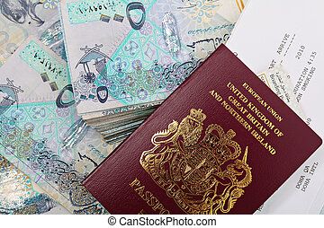 Qatar cash and passport - A new British passport with a...