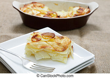 Serving potato Anna - A portion of potatoes anna - layers of...