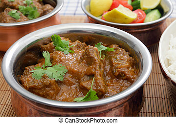 Madras beef curry bowl - A bowl of madras butter beef curry,...