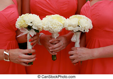 Bridesmaids bouquets - Close-up of bridesmaids holding their...
