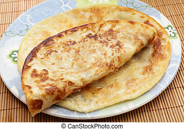 Indian paratha flatbread - Parathas, a popular Indian and...
