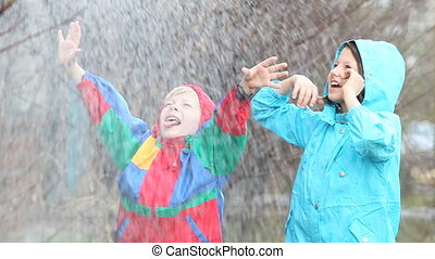 Heavy rain - Children having fun in rainy weather